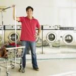 Asian man in laundromat — Stock Photo #52040585