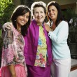 Three generations of women smiling for the camera — Stock Photo #52040713