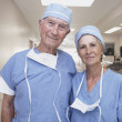 Senior male and female doctors wearing scrubs in hospital — Stock Photo #52041395
