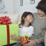 Hispanic brother and sister exchanging Christmas gifts — Stock Photo #52041621