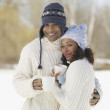African couple hugging in hats and sweaters — Stock Photo #52041791