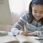 Young girl doing her homework — Stock Photo #52041891