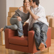 Young Hispanic couple kissing in new house — Stock Photo #52042091