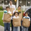 Hispanic family unloading grocery bags from car — Stock Photo #52042545