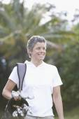 Cape Verdean woman on golf course — Stok fotoğraf