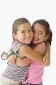 Two girls hugging — Stock Photo