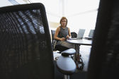 Businesswoman at desk in office — Stock Photo