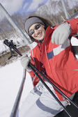 Woman smiling on ski lift — Stock Photo