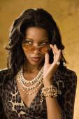 African woman wearing sunglasses — Stock Photo