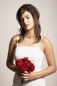 Asian bride holding flowers — Stock Photo