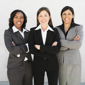 Multi-ethnic businesswomen with arms crossed — Stock Photo
