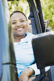 African woman sitting in jeep — Stock Photo