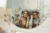 Young women trying on sunglasses — Stock Photo