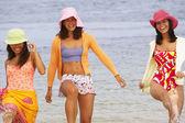 Three young women at beach — Stock Photo