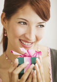 Hispanic woman holding gift — Stock Photo