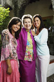 Three generations of women smiling for the camera — Stock Photo
