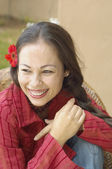 Woman smiling with flower in her hair — Stock Photo