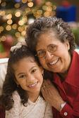 Hispanic grandmother and granddaughter smiling — Stock Photo