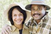Middle-aged African couple smiling outdoors — Stock Photo