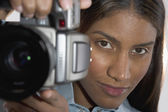 Woman holding camera — Stock Photo