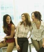 Multi-ethnic businesswomen laughing — Stock Photo