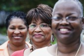 Three middle-aged African women smiling — Stock Photo