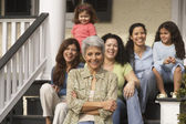 Hispanic grandmother with female family members in the background — Stock Photo