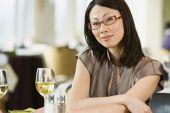 Asian businesswoman at restaurant — Stock Photo