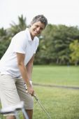 Cape Verdean woman on golf course — Stock Photo