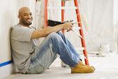 African man taking break from painting — Foto de Stock