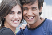 Hispanic couple smiling — Stock Photo