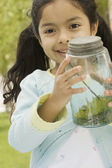 Young girl showing captured bug — Stock Photo