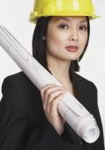 Asian businesswoman wearing a hard hat — Stock Photo