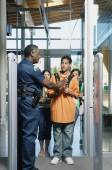 Security officer stopping teenager — Stock Photo