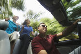 Man and women driving in convertible — Stock Photo