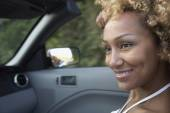 African woman in convertible car — Stock Photo