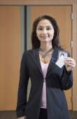 Businesswoman showing her credentials — Stock Photo