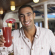 Hispanic man holding cocktail — Stock Photo #52066861