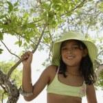 Hispanic girl in bathing suit under tree — Stock Photo #52067125