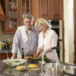Multi-ethnic couple preparing food — Stock Photo #52067185