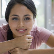 Young woman resting chin on fists — Stock Photo #52068193