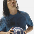 Asian male soccer player holding ball — Stok fotoğraf #52068427