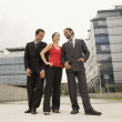 Multi-ethnic businesspeople standing outdoors — Stock Photo #52068501