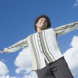 Mixed Race man with arms outstretched — Stock Photo #52068749
