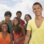 Multi-ethnic friends at beach — Stock Photo #52069211