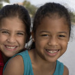 Mixed Race sisters in front of water — Stock Photo #52069349