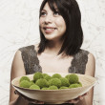 Hispanic woman holding home decor bowl — Stock Photo #52069549