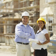 Pregnant Asian couple at construction site — Stock Photo #52069561