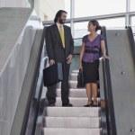 Hispanic businesspeople on escalator — Stock Photo #52069767