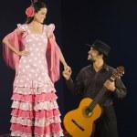 Hispanic female flamenco dancer smiling at guitar player — Stock Photo #52069841